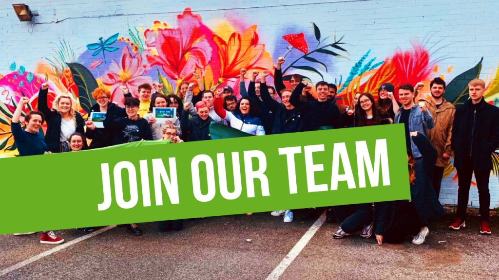 Join our team! img: young greens with fists in the air in front of colourful mural